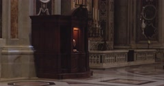 Priest and believers inside St. Peters Basilica Stock Footage