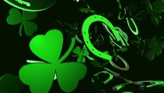 Horseshoe with green clover on black Stock Footage