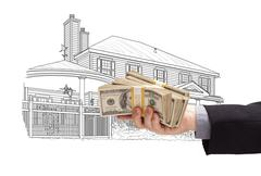Hand Holding Thousands of Dollars In Cash Over House Drawing. Stock Illustration