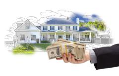 Hand Holding Thousands of Dollars In Cash Over House Drawing and Photo Area. - stock illustration