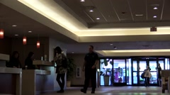 Semi busy hotel front desk lobby area with sound Stock Footage