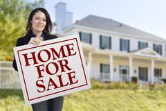 Smiling Hispanic Female Holding Sold For Sale Sign In Front of Beautiful Hous - stock illustration