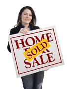 Hispanic Woman Holding Sold Home For Sale Real Estate Sign Isolated On White. - stock illustration