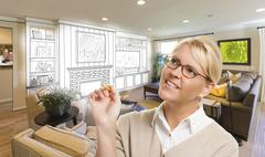 Creative Woman with Pencil Over Custom Living Room and Design Drawing. - stock photo
