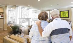 Senior Couple Over Custom Living Room Design Drawing and Photo - stock illustration