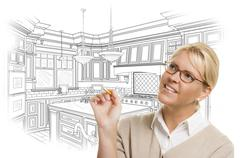 Creative Woman With Pencil Over Custom Kitchen Design Drawing on White. - stock photo