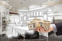 Hand Holding Cash Over Kitchen Design Drawing and Photo Combination - stock illustration