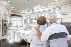 Senior Couple Looking Over Custom Kitchen Design Drawing and Photo Combinatio - stock illustration