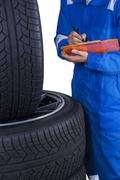 Technician checks tires condition - stock photo