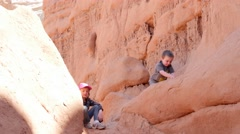 Little kids playing at Goblin Valley Stock Footage