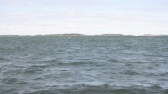 The cold sea roaming during the midsummer in Pohjanlahti in Kustavi - stock footage