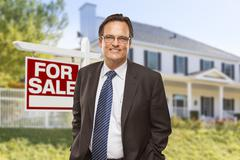 Male Real Estate Agent in Front of Home For Sale Sign and House. - stock illustration