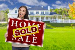 Mixed Race Female with Sold Sign In Front of House Stock Illustration