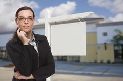 Woman In Front Commercial Building and Blank Real Estate Sign - stock photo