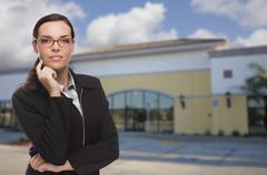 Woman In Front of Commercial Building - stock photo
