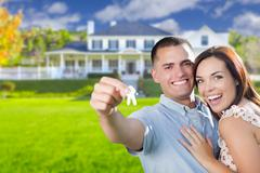 Military Couple with House Keys In Front of New Home - stock photo