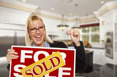 Young Woman Holding Sold Sign and Keys Inside New Kitchen - stock illustration