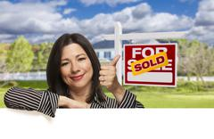 Hispanic Woman in Front of Sold For Sale Sign, House - stock illustration