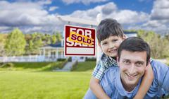 Mixed Race Father, Son Piggyback, Front of House, Sold Sign - stock illustration