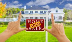 Female Hands Framing Sold Home For Sale Real Estate Sign in Front of New Hous Stock Illustration