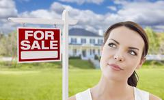Thinking Woman In Front of House and For Sale Sign - stock illustration