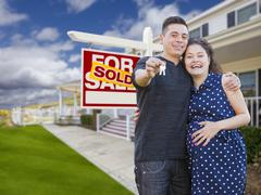 Hispanic Couple with Keys In Front of Home and Sign - stock illustration
