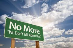 No More - We Don't Talk About That Green Road Sign - stock photo