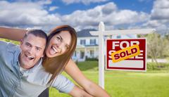 Stock Illustration of Playful Excited Military Couple In Front of Home with Sold Real Estate Sign.