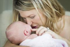 Young Caucasian Beautiful Mother Holding Her Precious Newborn Baby Girl. Stock Photos