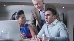 4K Three business people discussing work on laptop computer - stock footage
