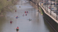 People canoeing down the don river in the city of Toronto on a sunny spring day Stock Footage