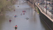 Stock Video Footage of People canoeing down the don river in the city of Toronto on a sunny spring day