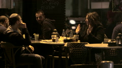 Conversation in the Coffee Shop at Night Stock Footage