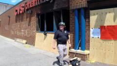 ATF agents at charred riot scene at CVS in Baltimore, MD  - stock footage