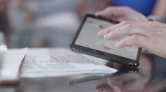 4K Hands using computer tablet in business meeting with business group Arkistovideo
