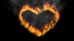 Burning heart and iron arrow - stock footage
