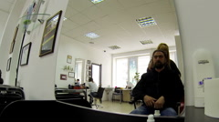 Man having an haircut in the barber shop, 04 may 2015 Stock Footage