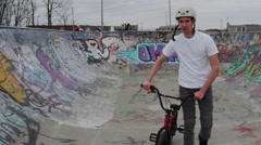 Stock Video Footage of Extreme Sport Lifestyle Shot - Slow Motion Bike Rider in Skatepark