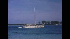 Vintage 16mm film, 1963, motorsailer crusing in the Bahamas Stock Footage
