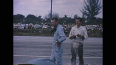 Vintage 16mm film, drivers pre-race, Penske, Stirling Moss Stock Footage
