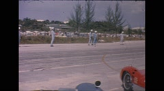 Vintage 16mm film, drivers waiting on race lane for lemans start Stock Footage