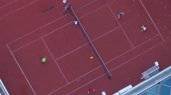 Young sportsmen training tennis on court. Stock Footage