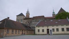 Akershus Fortress in the city of Oslo Norway pan of the main building Stock Footage