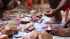 Man cutting meat of slaughtered animal. Stock Footage