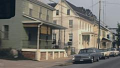 USA 1972: driving in a small town Stock Footage