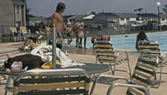 USA 1972: people in an outdoor swimming pool Stock Footage