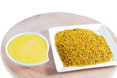 Natural honey and bee pollen . Stock Photos