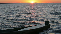 Sunset and drowned boat on summer lake bank. Stock Footage
