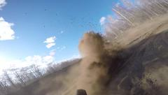 Stock Video Footage of slow motion of dirtbike roosting berm with POV of rear