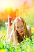 Sensual woman in a flowery meadow - stock photo